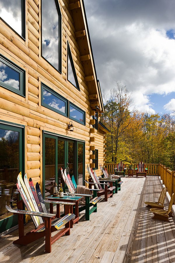 Outdoor, Large Patio, Porch, Deck, Wood Patio, Porch, Deck, and Trees A family-run business in Woodsville, NH. Coventry Log Homes offers a range of log home kits from tiny cabins, to large-scale homes. The use kiln-dried White Pine logs all sourced within an 80-mile radius of their factory.  Photo 6 of 8 in 7 East Coast Kit Home Companies