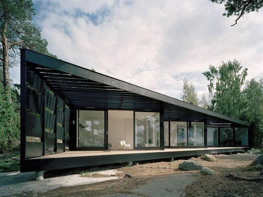 A light-weight building in glass and wood, this summerhouse in the Stockholm archipelago has been inspired by its location with its dark wood exterior and abundance of windows to take in the stunning view.  <span style= Tagged: Exterior, Wood Siding Material, Cabin Building Type, and Glass Siding Material.  Photo 5 of 10 in A Look at 10 Minimalist Scandinavian Cabins