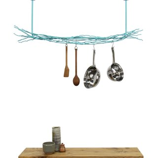 10 Functional Pieces For Small Space Living - Photo 7 of 11 - This modern pot rack from Merkled Studio is made from salvaged steel loom ends collected from a weaving company located only 10 blocks from the designer's studio. Able to hold even the heaviest cast-iron skillet, each organic piece has also been powder-coated for durability.