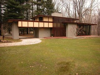 Each home that Wright designed was unique to its circumstances, and the Penfield House was no exception. Set on 30 acres in Lake County, Ohio, Wright designed the house in the 1950s with taller ceilings than the other Usonians had, and an elongated profile to accommodate his client Louis Penfield—who was six foot eight.