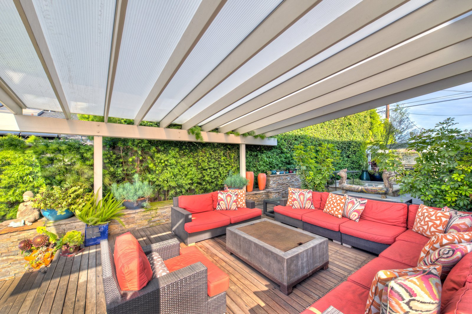 Outdoor Equipped with outdoor living, kitchen and dining areas—and a stunning fire pit, the deck also boasts a built-in spa.  Photo 2 of 9 in On the Market For $4.5M, This Venice Beach Compound Captures the Essence of Indoor-Outdoor Living