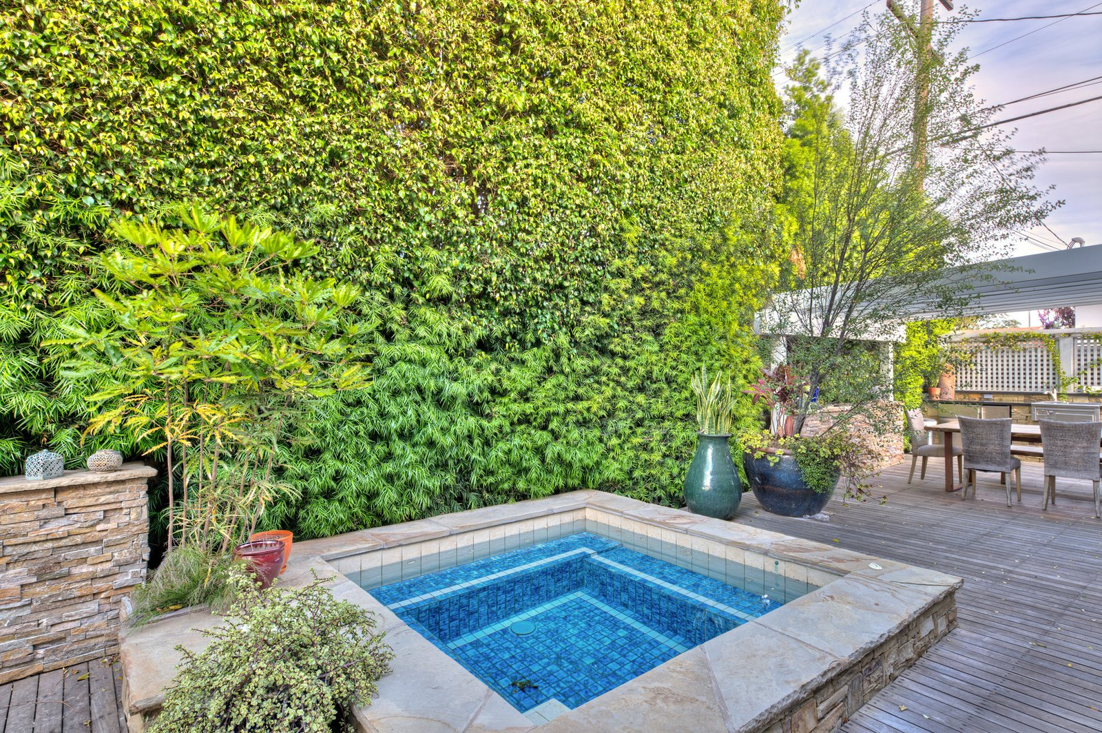 Outdoor The privately enclosed deck is set back behind mature landscaping and also boasts a built-in spa.  Photo 3 of 9 in On the Market For $4.5M, This Venice Beach Compound Captures the Essence of Indoor-Outdoor Living