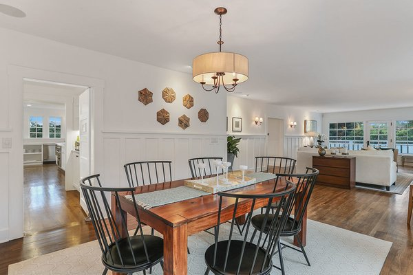 The dining room is adjacent to the living room and offers easy access to the kitchen and butler's pantry—perfect for entertaining.  Photo 4 of 11 in With an Architectural Pedigree and Green Certification, This Pasadena Home Just Listed For $3.6M