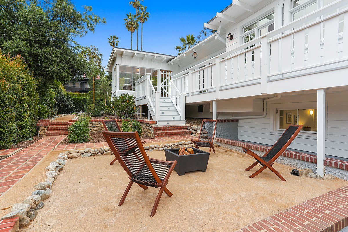 The landscaping of the garden includes orange and pomegranate trees, vegetable plots, and a new bocce ball court.  Photo 9 of 11 in With an Architectural Pedigree and Green Certification, This Pasadena Home Just Listed For $3.6M