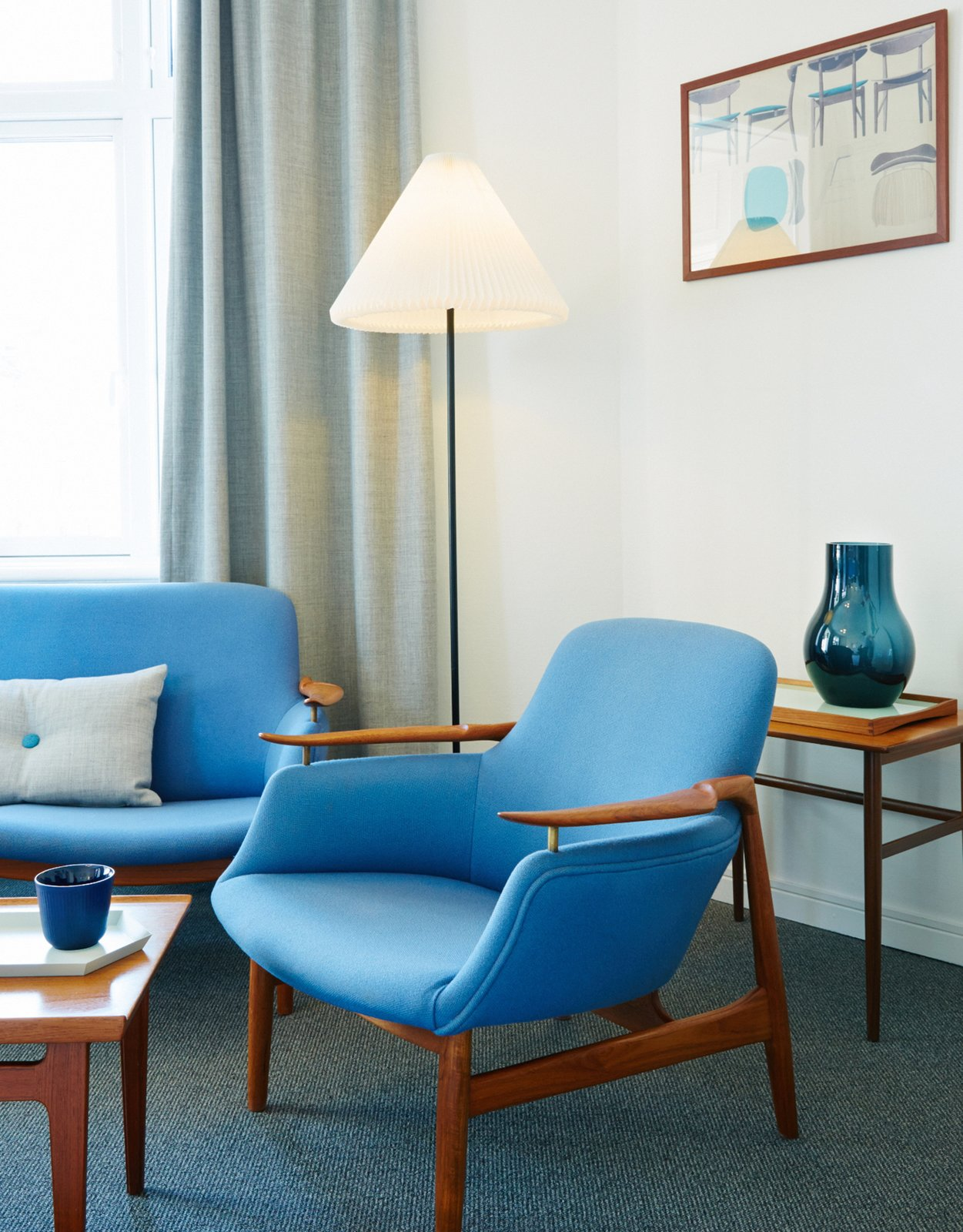 Living Room, Coffee Tables, Carpet Floor, Chair, Sofa, and Lamps Finn Juhl Deluxe Room  Photo 7 of 9 in Get Your Fix of Midcentury Scandinavian Design at This Copenhagen Hotel