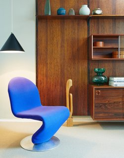 A royal blue Panton 1-2-3 Lounge Chair completes the Collector's Suite. All of the furniture in this space is for sale.