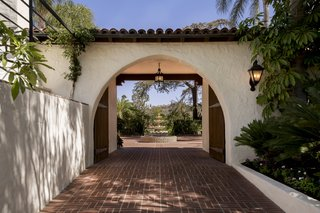 Historic charm abounds throughout the property with terracotta tiled arches and white stucco walls.