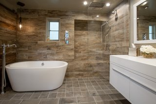 The guest quarters' renovations include updated bathrooms features such as a floating Gessi vanity.