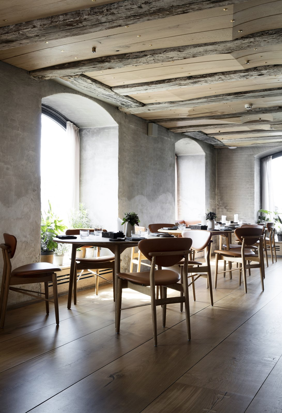 The ceiling is alternately composed of the original ceiling beams and new, sculpted wooden planks, which are embedded with brass details that reflect micro spots of light.  Photo 5 of 10 in Snøhetta Designs the Interiors of Barr, the Noma Group's New  Copenhagen Restaurant