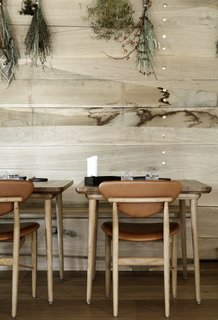 The restaurant's furniture was created by Malte Gormsen using traditional Danish craftsmanship and carpentry. The 108 Chairs are by Finn Juhl.