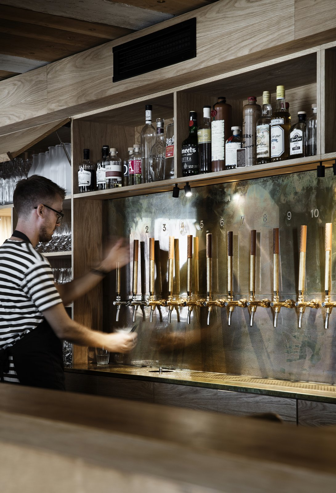The bar serves up a wide range of wine, beer, spirits and aquavits.  Photo 7 of 10 in Snøhetta Designs the Interiors of Barr, the Noma Group's New  Copenhagen Restaurant