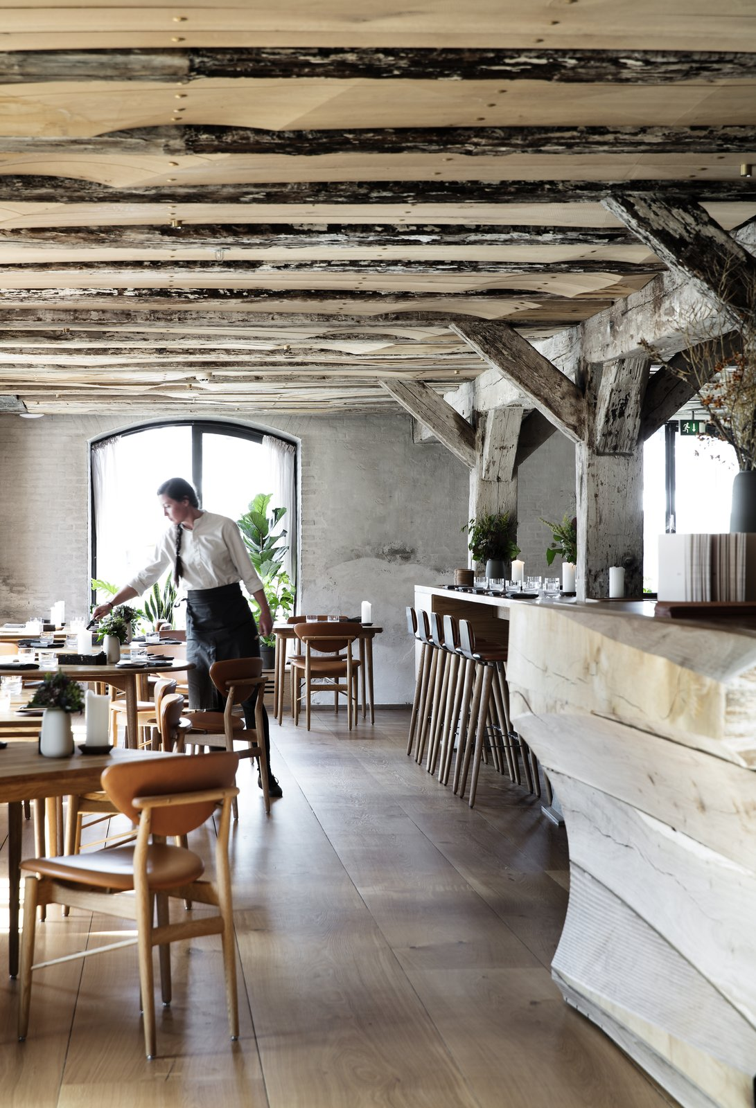 Upon entering the restaurant, guests are met with a warm oak floor, which is in contrast to the rough texture of the original stone walls.  Photo 4 of 10 in Snøhetta Designs the Interiors of Barr, the Noma Group's New  Copenhagen Restaurant