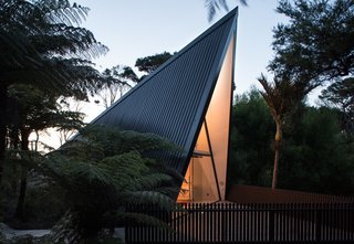"The front deck was designed to ""fan out""—giving the illusion of a shadow cast by the A-frame structure."