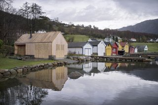 A New Book Examines the Art of Breathing Life Into Forgotten Architecture - Photo 11 of 16 - Koreo Arkitekter + Kolab Arkitekter created a modern boathouse out of local timber in Vikebygd, Norway, which fits naturally into the traditional context of its location.