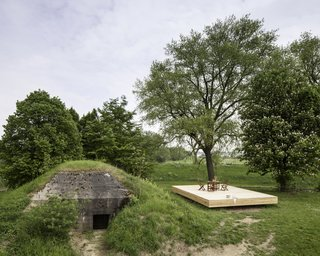 8 Subterranean Homes That Are Out of This World - Photo 4 of 8 - Architect Bruno Despierre of Brussels-based firm B-ILD transformed a 140-square-foot, former Dutch military bunker in the Netherlands into a snug underground vacation home with multipurpose furniture  made from meranti-finished plywood.