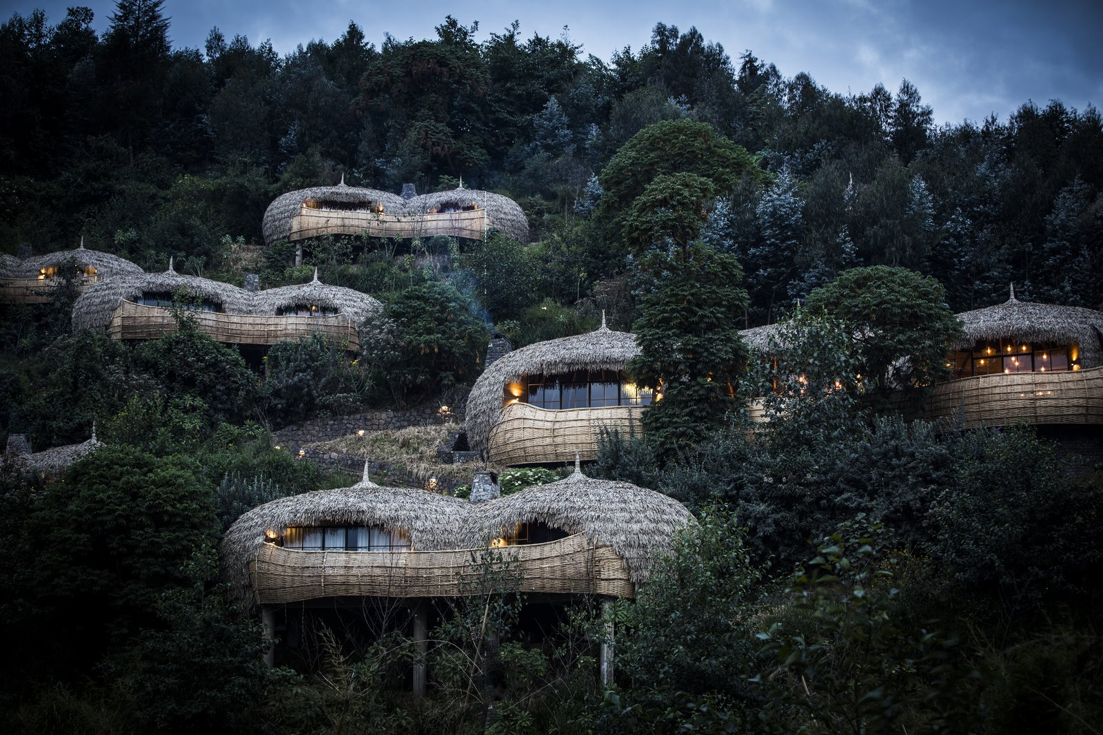 The spherical, thatched structures echo the thousands of hills that dot the Rwandan countryside.  Photo 10 of 11 in Take an Eco-Escape to a Spherical Forest Villa in an Eroded Volcanic Cone in Rwanda