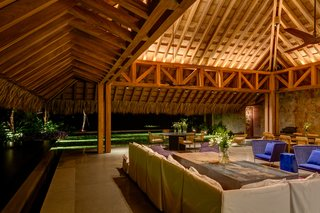 The living/dining area is in a palapa made of natural parota wood, which is over 33 feet high.