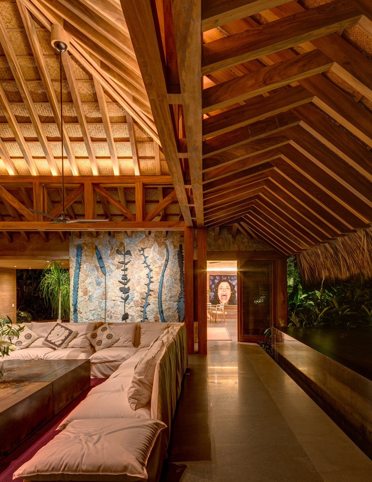 Living Room, Ceiling Lighting, Sectional, Cement Tile Floor, and Coffee Tables The traditional thatched roof has been given a contemporary spin.  Photo 6 of 14 in This Expansive Beachside Home on Mexico's Pacific Coast Puts a Modern Spin on Tradition