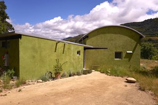 "The color green was selected for the exterior plaster, because it integrates into the landscape, and symbolizes the concept of ""green living""."