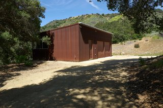 A Corten-clad 630-square-foot separate structure houses a two-car garage and an art studio.