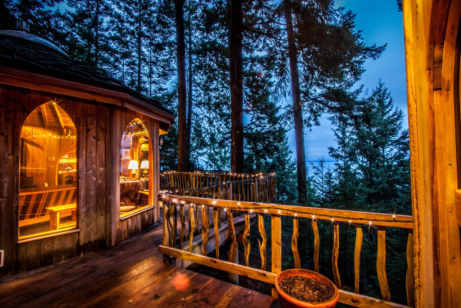 Orcas Island, this breathtaking treehouse features cathedral ceilings, a round soaking tub, and a 12-sided living room with amazing views. Explore the great outdoors, or just relax in the home's cozy interior.  Photo 2 of 17 in 8 Unique Vacation Rentals Around the World