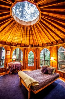 The rotunda bedroom features a skylight and a distinctly Pacific Northwest forest vibe.