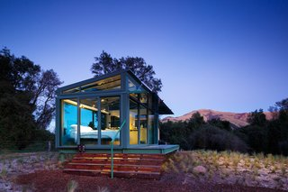 8 Unique Vacation Rentals Around the World - Photo 5 of 16 - This state-of-the-art living capsule on New Zealand's South Island features glass roofing, flooring, and walls to provide the ultimate panoramic view of the wilderness.
