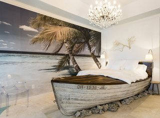 Another room offers guests a chance to sleep in a boat-shaped bed.