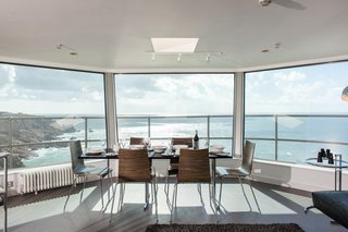 The dining room and living room area in the top observation deck.