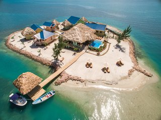 Powered by a state-of-the-art solar power system, you can literally go off the grid at this private island in Belize. The uniquely designed compound home includes five private suites specifically laid out to take advantage of the amazing sea and mountain views and the cool trade winds off the Placencia Peninsula in southern Belize.