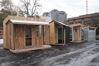 """PODs designed by SERA Architects, Portland State University, LRS Architects, and Mackenzie on display in downtown Portland. The architect-designed units humanized the project, leading people to even think """"I could live in that."""""""