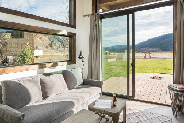 Sliding doors open to a deck offering incredible views of the local landscape.
