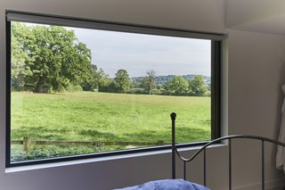 The master bedroom suite boasts a large picture window with far-reaching rural views.