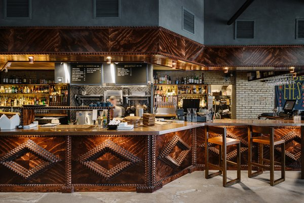 Both guests and locals can enjoy the bar and kitchen, which serves breakfast, lunch, and dinner.