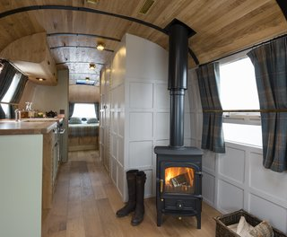 Called the English country retreat, this renovated interior that was done by ARC Airstreams features quality furnishings and fttings, Leadlight windows, and a fully functional fireplace.