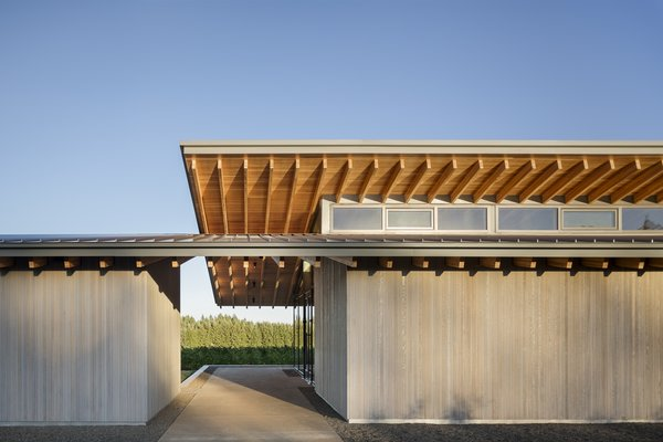 Inspired by the canopied, native oak trees that populate the valley, two cantilevered roof structures interlock at the tasting room's entryway. The material palette is limited to Douglas fir, cedar siding, and dark anodized aluminum.