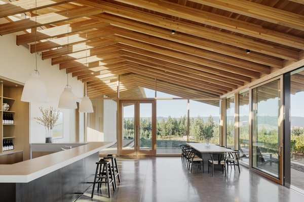 Two large sliding doors centered with the tasting room bar bring the vineyard into the space, while also serving as a passive cooling system in the summer when used in tandem with the upper clerestory windows.