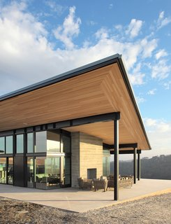 The design is focused on the unobstructed views of the estate's vineyard, along with a simple process flow for its handcrafted approach to wine making.