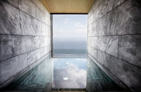 The wellness center is divided into two areas: a wet zone with a stone swimming pool, sauna, and Turkish bath; plus a separate zone for spa treatments.