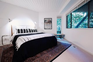 Three comfortable bedrooms are located on the lower level.