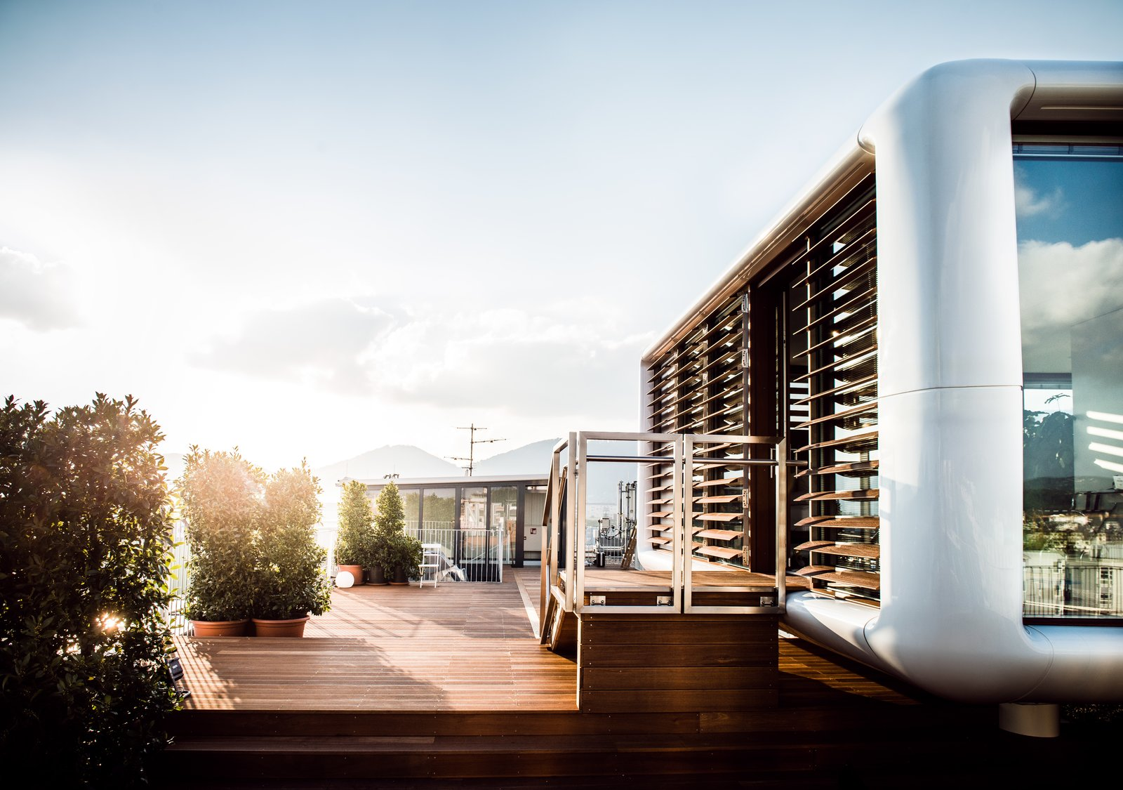 Outdoor, Rooftop, and Wood Patio, Porch, Deck  Photo 3 of 8 in Stay in a Prefab Cube Placed Atop a Midcentury Hotel in Austria