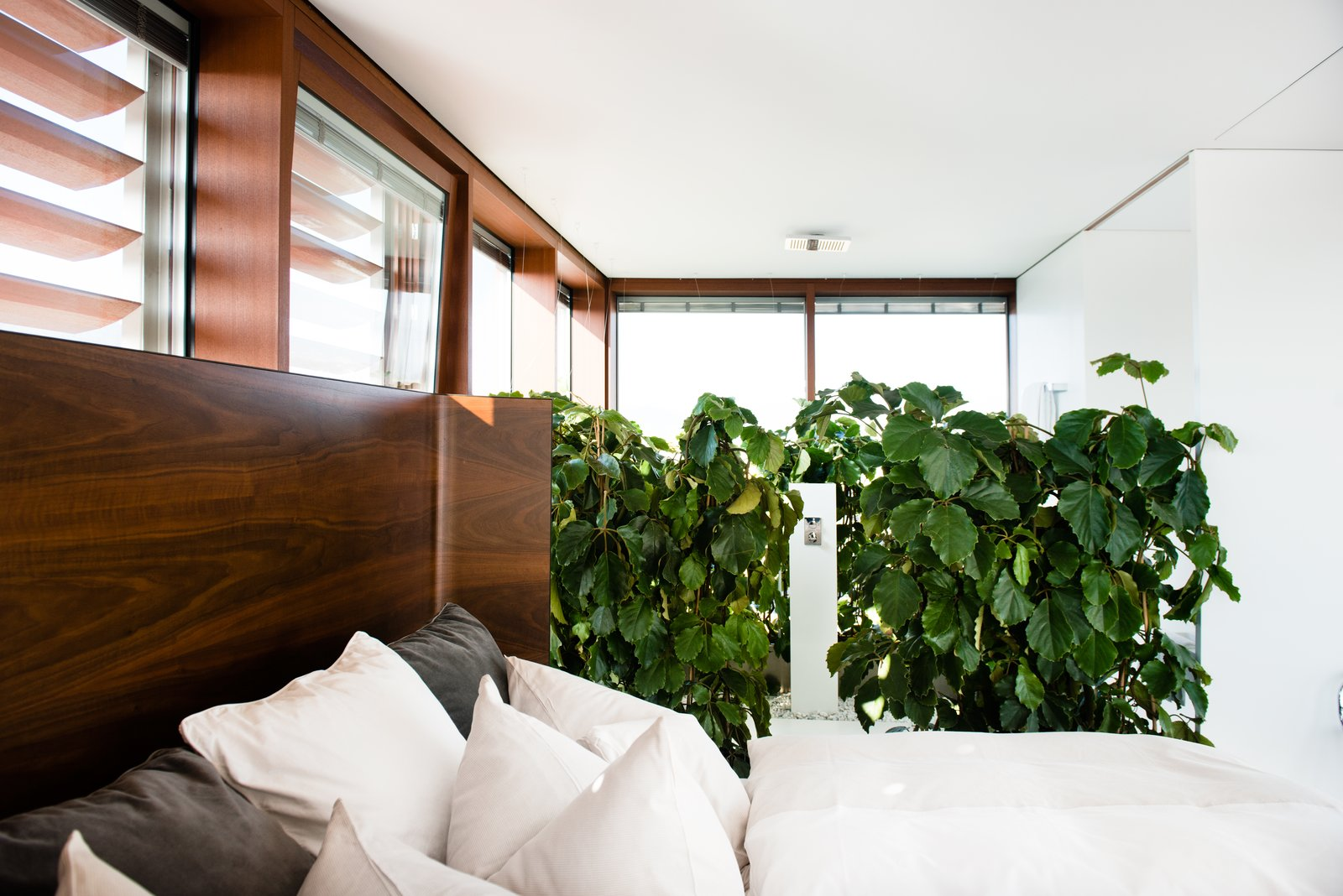 Bedroom and Bed  Photo 7 of 8 in Stay in a Prefab Cube Placed Atop a Midcentury Hotel in Austria