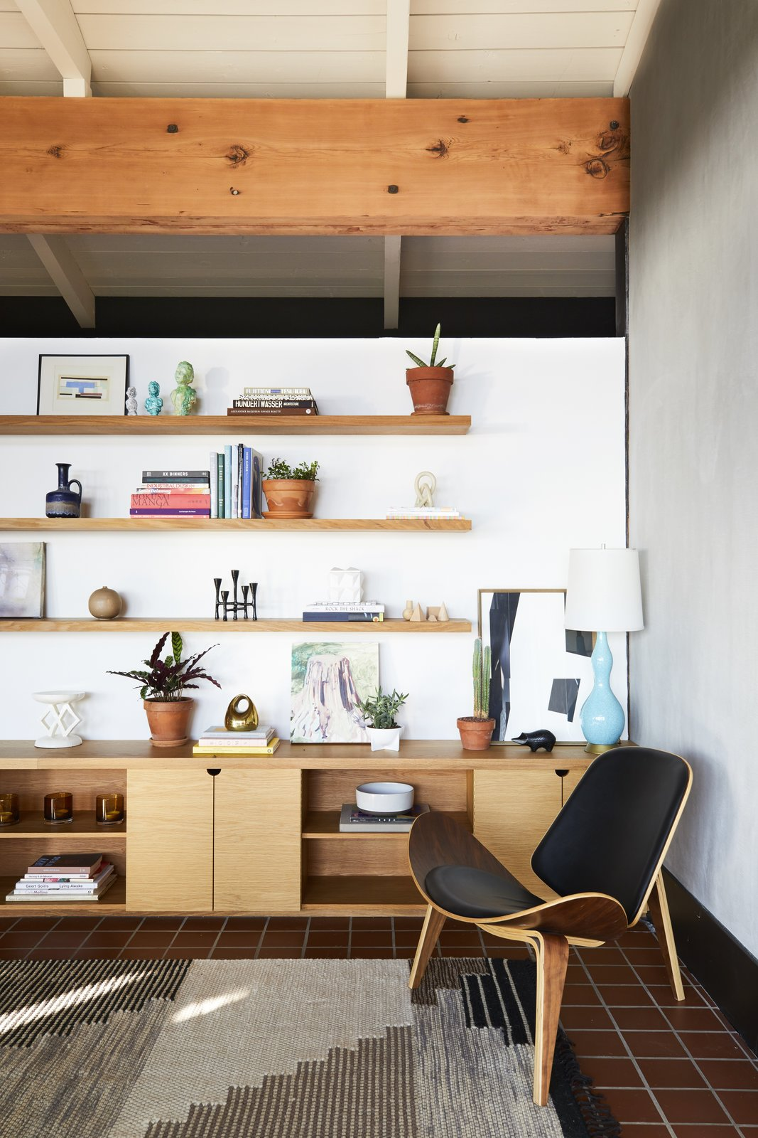 Living, Chair, Shelves, Storage, Rug, Table, and Terra-cotta Tile  Best Living Shelves Terra-cotta Tile Photos from A Hudson Valley Home's Renovation Is Guided by its Best Midcentury Feature