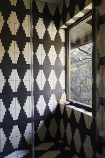 Graphic black-and-white cement tile was added in the renovation.