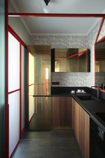 In the kitchen, the doors are made out of brass and eucalyptus wood while the lighting is from Atelier Areti. The countertops are made with high-thickness laminate Polaris by Abet Laminati and were designed by Marcante-Testa and built by Materia Design and Om Project. The faucets are from Bellosta.