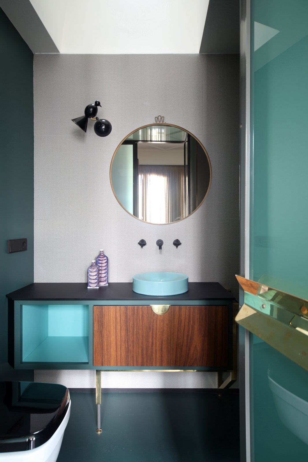 Bath Room, Wall Lighting, One Piece Toilet, Vessel Sink, and Enclosed Shower  Photo 23 of 24 in This Venetian Apartment Is Bursting With Incredible European Furnishings