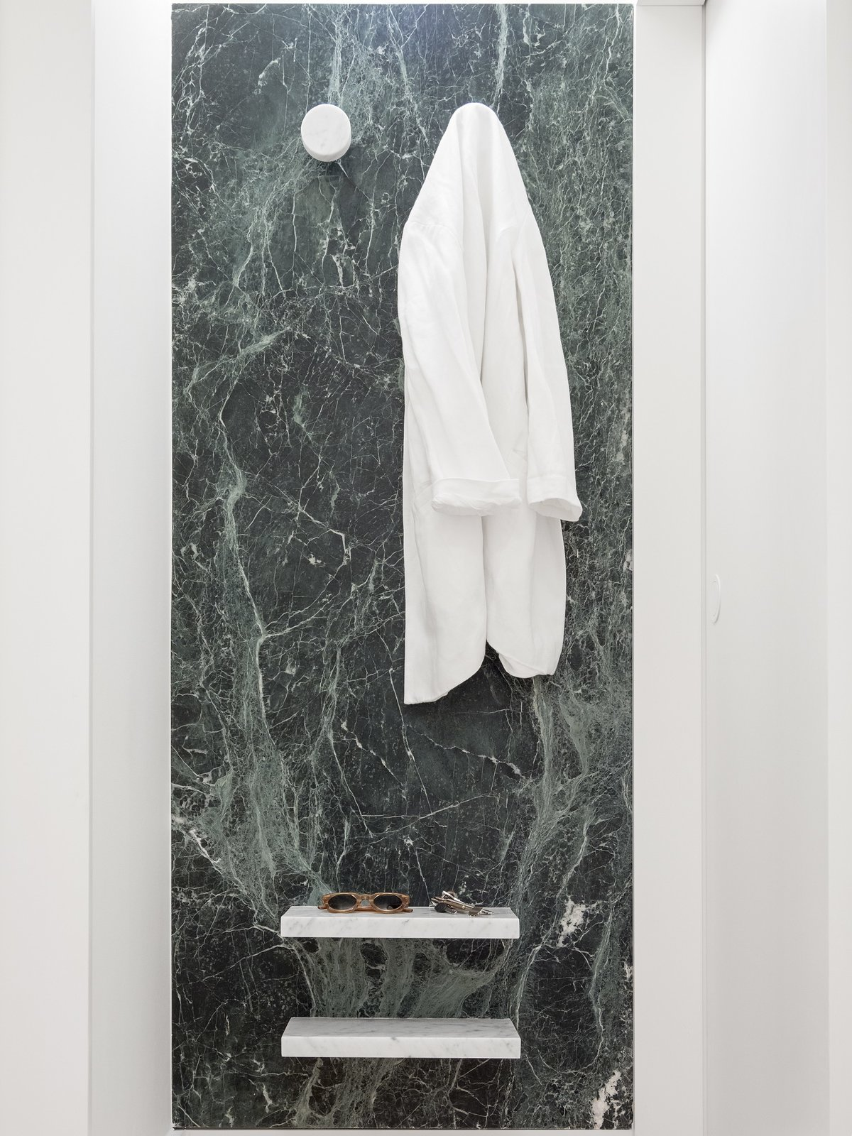 Bath Room and Marble Wall  Photo 9 of 16 in A Luminous Renovation in Portugal Creates a Bright and Airy Apartment