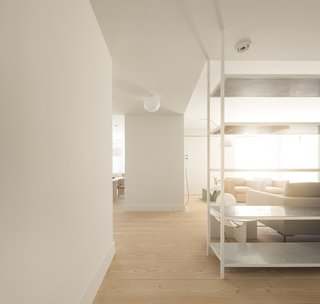 A Luminous Renovation in Portugal Creates a Bright and Airy Apartment - Photo 3 of 15 -