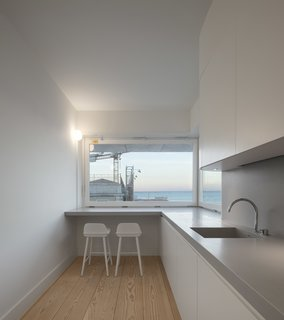 A Luminous Renovation in Portugal Creates a Bright and Airy Apartment - Photo 9 of 15 -