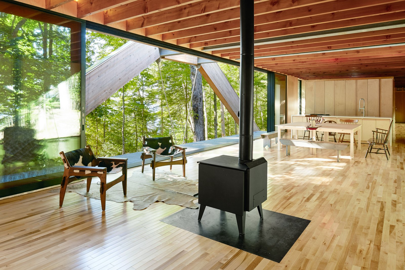 Living Room, Chair, and Standard Layout Fireplace  Photo 5 of 12 in A Unique Home in the Canadian Forest That Doubles As a Bridge